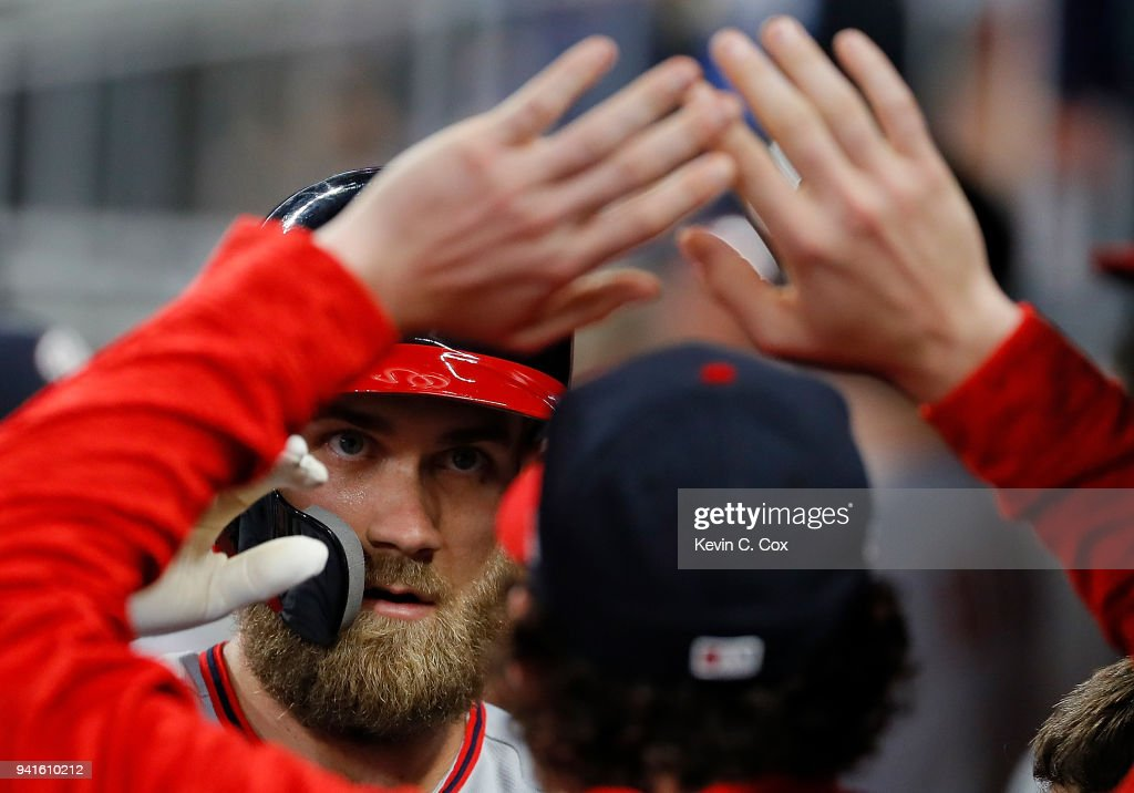 Bryce Harper #34 of the Washington Nationals reacts after hitting a solo homer in the third inning against the Atlanta Braves at SunTrust Park on April 3, 2018 in Atlanta, Georgia.