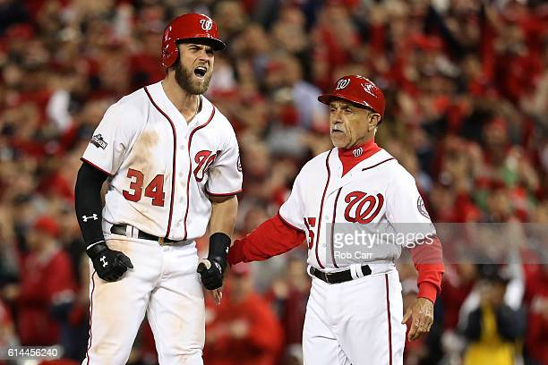 Bryce Harper of the Washington Nationals reacts after hitting a single against the Los Angeles Dodgers in the seventh inning during game five of the...