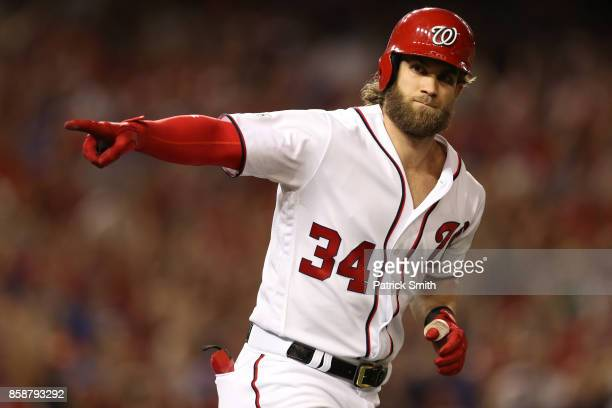 Bryce Harper of the Washington Nationals reacts after hitting a two run home run against the Chicago Cubs in the eighth inning during game two of the...