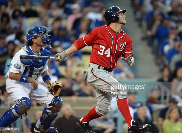 Bryce Harper of the Washington Nationals reacts to his fly out in his major league debut against the Los Angeles Dodgers during the second inning at...