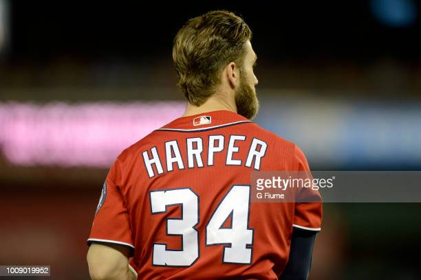 Bryce Harper of the Washington Nationals rests during a break in the game against the Los Angeles Dodgers at Nationals Park during game two of a...