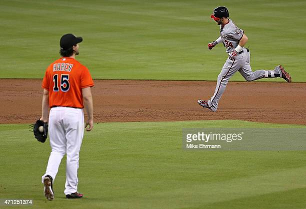 Bryce Harper of the Washington Nationals rounds the bases after hitting a hmoe run off of Dan Haren of the Miami Marlins during a game at Marlins...