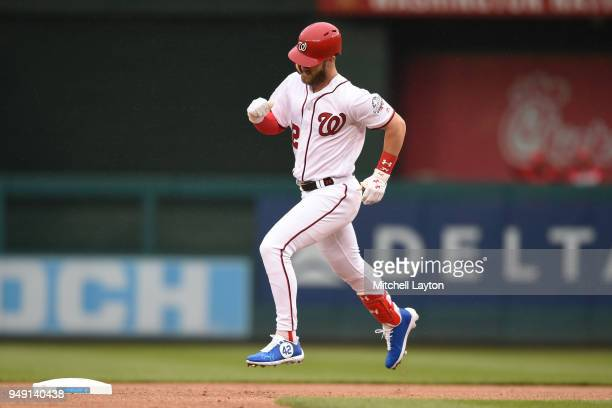 Bryce Harper of the Washington Nationals rounds the bases after hitting a home run during a baseball game against the Colorado Rockies at Nationals...