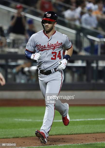 Bryce Harper of the Washington Nationals rounds the bases after hitting a two run home run against Tim Peterson of the New York Mets in the seventh...