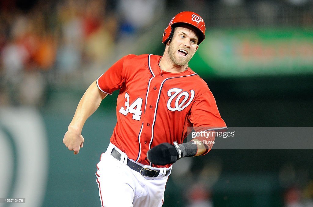 Bryce Harper #34 of the Washington Nationals rounds third base and scores the game winning run in the ninth inning against the Pittsburgh Pirates at Nationals Park on August 16, 2014 in Washington, DC. Washington won the game 4-3.