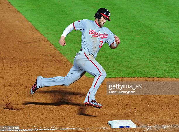 Bryce Harper of the Washington Nationals rounds third base to score a ninthinning run against the Atlanta Braves at Turner Field on April 27 2015 in...