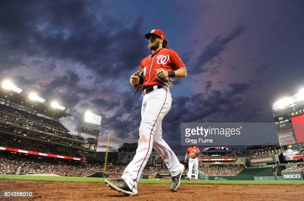 Bryce Harper of the Washington Nationals runs in from the outfield in the sixth inning against the Colorado Rockies at Nationals Park on July 29 2017...