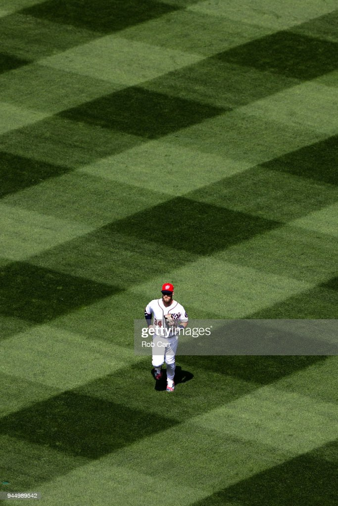 Bryce Harper #34 of the Washington Nationals runs in from the outfield during the end of the eighth inning against the Atlanta Braves at Nationals Park on April 11, 2018 in Washington, DC.