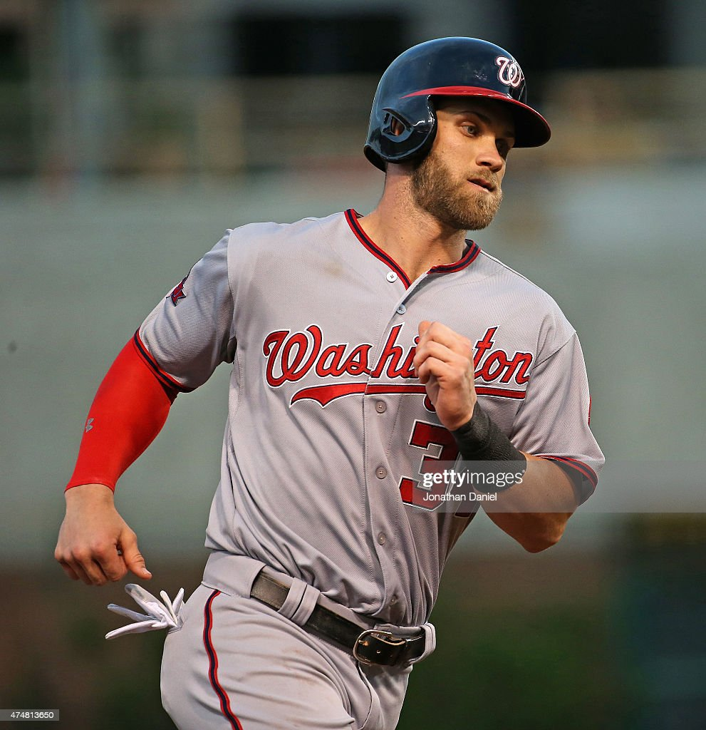 Bryce Harper #34 of the Washington Nationals runs the bases after hitting a game-tying home run in the 7th inning against the Chicago Cubs at Wrigley Field on May 26, 2015 in Chicago, Illinois.