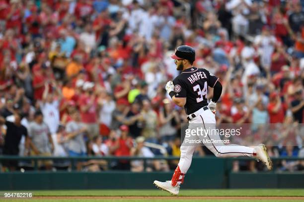 Bryce Harper of the Washington Nationals runs the bases after hitting a leadoff home run in the first inning against the Philadelphia Phillies at...