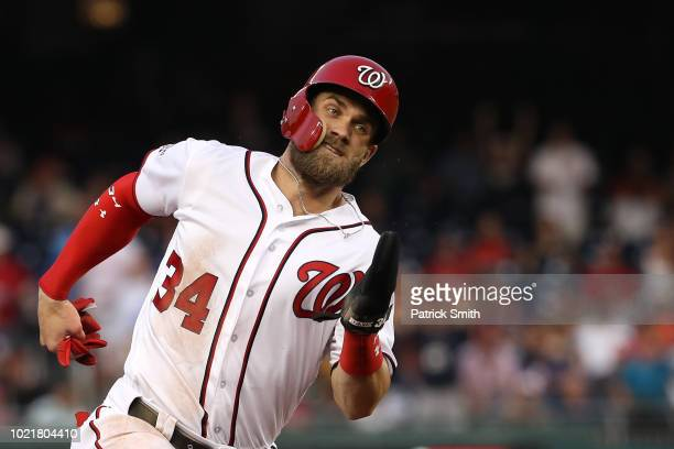 Bryce Harper of the Washington Nationals runs the bases before scoring against the Philadelphia Phillies during the first inning at Nationals Park on...