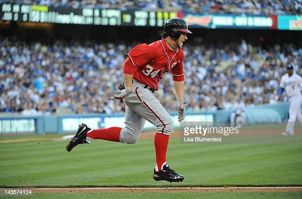 Bryce Harper of the Washington Nationals runs to first base during his major league debut against the Los Angeles Dodgers at Dodger Stadium on April...