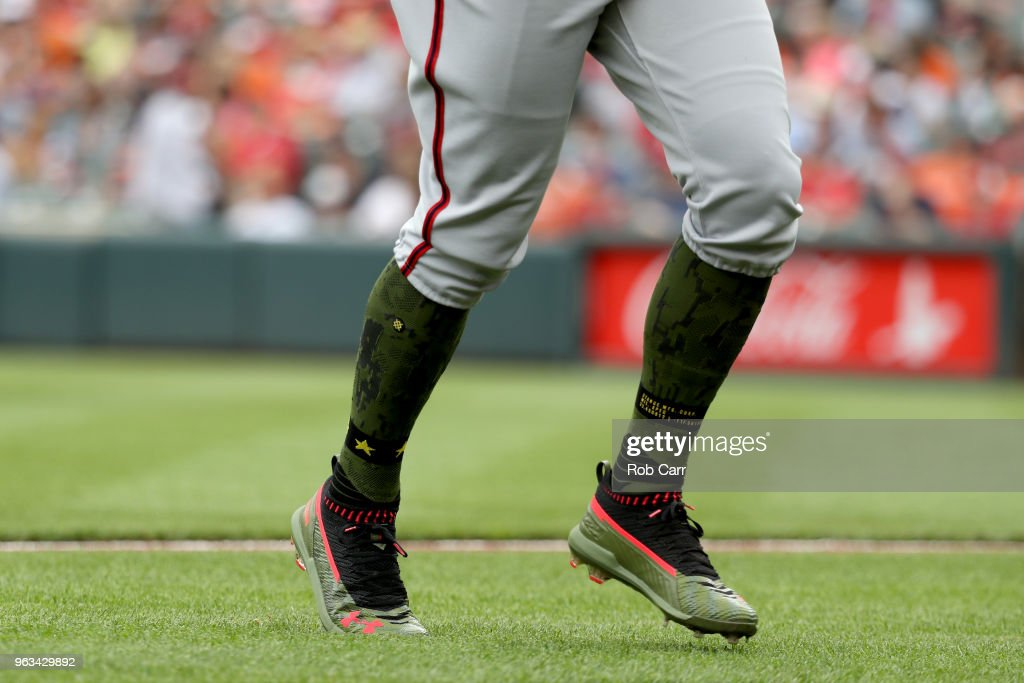 Bryce Harper #34 of the Washington Nationals runs to the dugout against the Baltimore Orioles at Oriole Park at Camden Yards on May 28, 2018 in Baltimore, Maryland. MLB players across the league are wearing special uniforms to commemorate Memorial Day.
