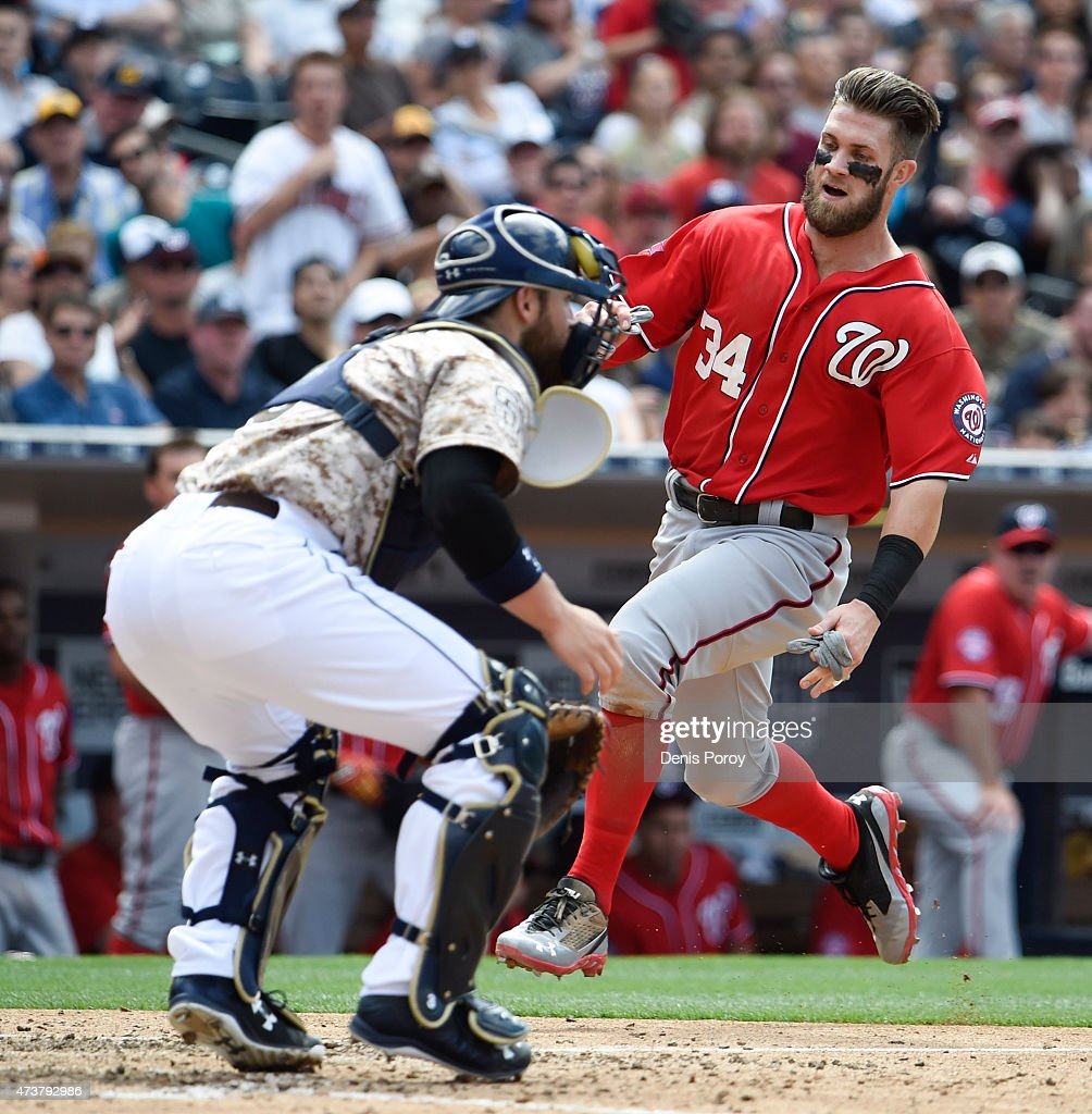 Bryce Harper #34 of the Washington Nationals scores ahead of the throw to Derek Norris #3 of the San Diego Padres during the sixth inning of a baseball game at Petco Park May 17, 2015 in San Diego, California.