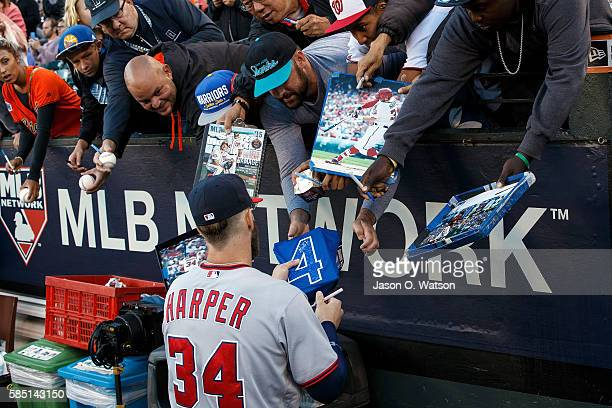Bryce Harper of the Washington Nationals signs autographs in the dugout before the game against the San Francisco Giants at ATT Park on July 28 2016...