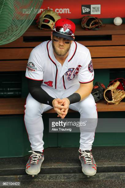 Bryce Harper of the Washington Nationals sits in the dugout before the start of a game against the San Diego Padres at Nationals Park on Wednesday...