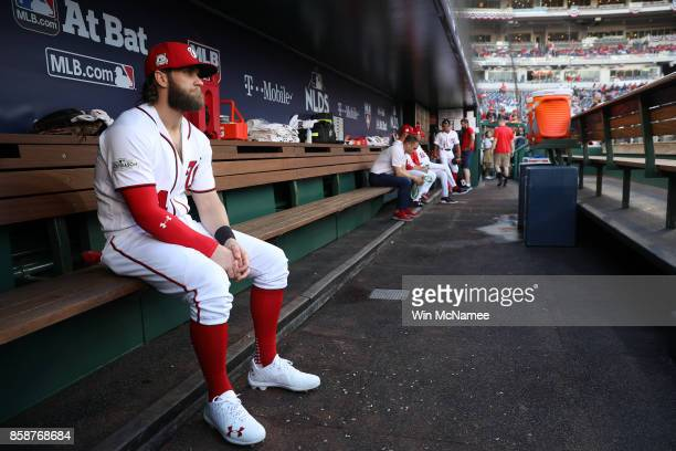 Bryce Harper of the Washington Nationals sits in the dugout prior to game two of the National League Division Series against the Chicago Cubs at...