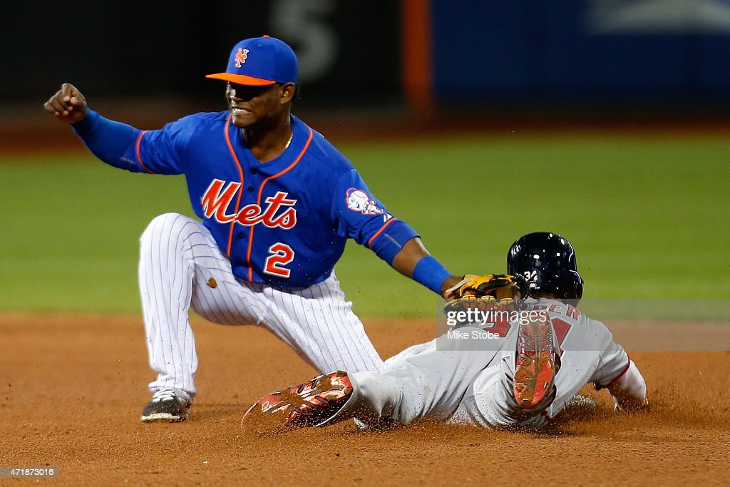 Bryce Harper #34 of the Washington Nationals slides in safe but is later ruled out after video replay as Dilson Herrera #2 of the New York Mets reacts at Citi Field on May 1, 2015 in the Flushing neighborhood of the Queens borough of New York City.
