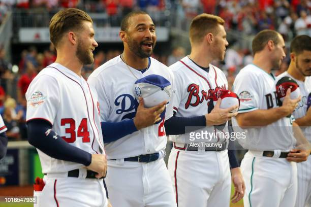 Bryce Harper of the Washington Nationals speaks with Matt Kemp of the Los Angeles Dodgers during the 89th MLB AllStar Game at Nationals Park on...