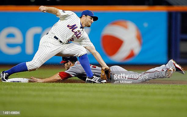 Bryce Harper of the Washington Nationals steals second base in the third inning ahead of the tag from Daniel Murphy of the New York Mets at Citi...