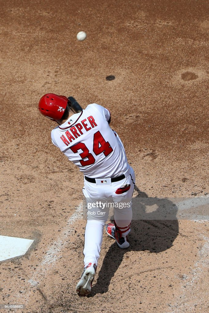 Bryce Harper #34 of the Washington Nationals swings at a pitch against the Atlanta Braves at Nationals Park on April 11, 2018 in Washington, DC.