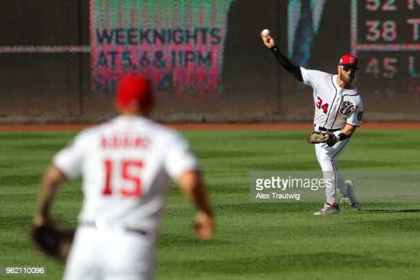 Bryce Harper of the Washington Nationals throws during a game against the San Diego Padres at Nationals Park on Wednesday May 23 2018 in Washington DC