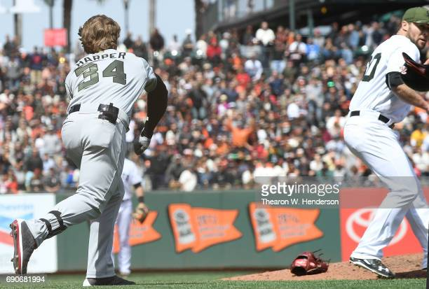 Bryce Harper of the Washington Nationals throws his helmet at Hunter Strickland of the San Francisco Giants after Strickland hit Harper with a pitch...