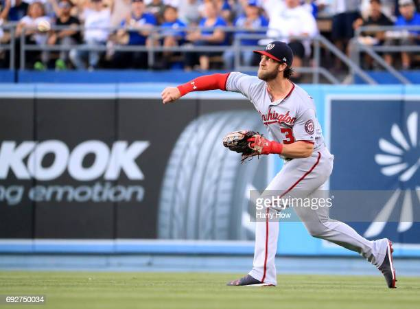 Bryce Harper of the Washington Nationals throws out Corey Seager of the Los Angeles Dodgers at second base in a fielder's chice during the first...