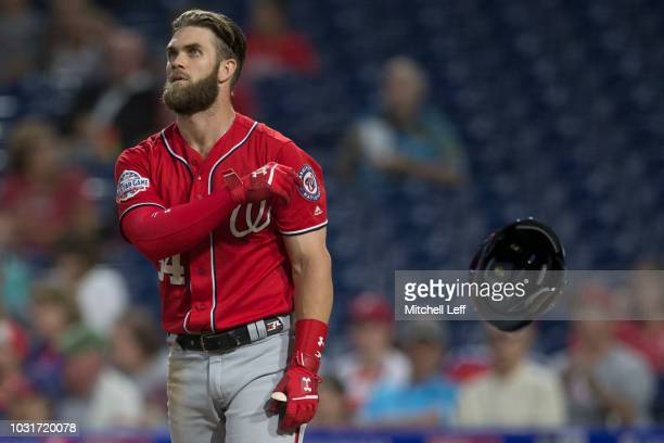 Bryce Harper of the Washington Nationals tosses his helmet after striking out to end the first inning against the Philadelphia Phillies in game two...