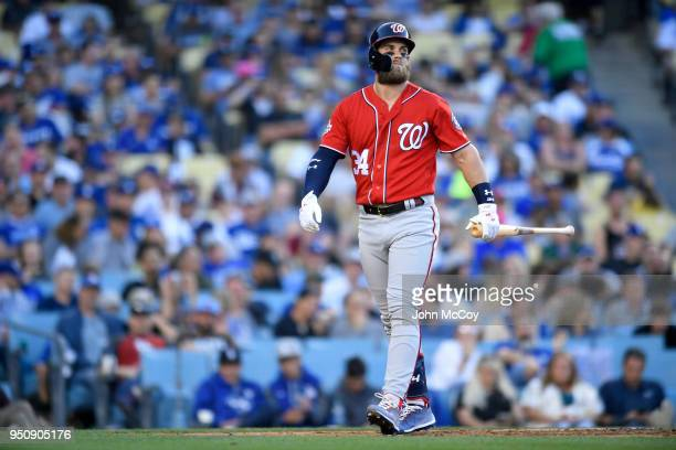 Bryce Harper of the Washington Nationals walks around after a foul tip went off his foot in the fifty inning against the Los Angeles Dodgers at...