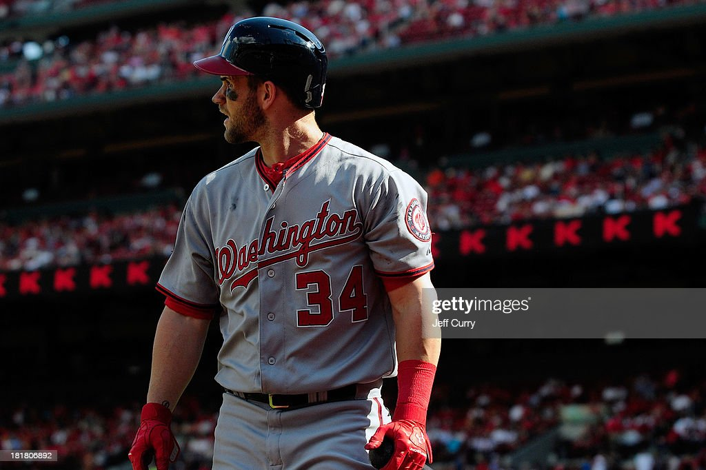 Bryce Harper #34 of the Washington Nationals walks back to the dugout after striking out against Trevor Rosenthal #26 of the St. Louis Cardinals during the ninth inning at Busch Stadium on September 25, 2013 in St. Louis, Missouri. The Cardinals won 4-1 to sweep the Nationals.