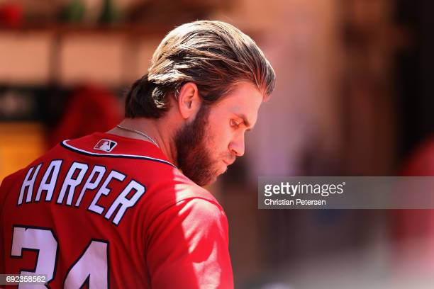 Bryce Harper of the Washington Nationals walks in the dugout during the sixth inning of the MLB game against the Oakland Athletics at Oakland...