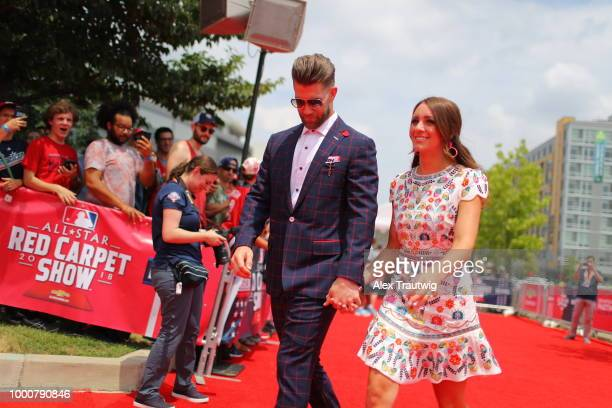 Bryce Harper of the Washington Nationals walks the red carpet with his wife during the MLB Red Carpet Show at Nationals Park on Tuesday July 17 2018...