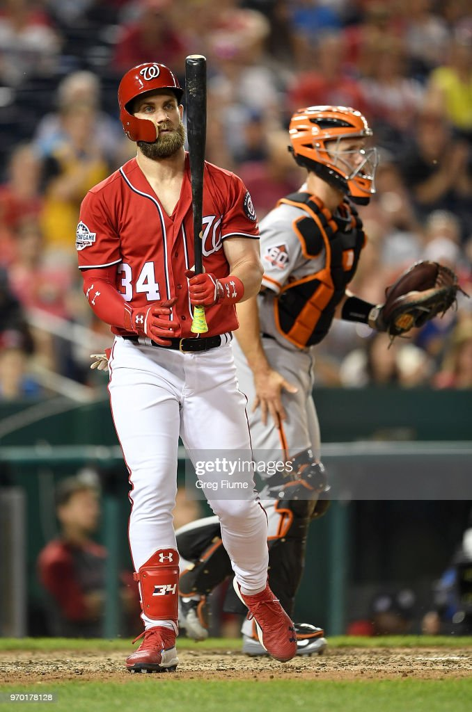 Bryce Harper #34 of the Washington Nationals walks to the dugout after striking out to end the game against the San Francisco Giants at Nationals Park on June 8, 2018 in Washington, DC.