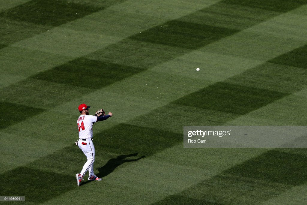 Bryce Harper #34 of the Washington Nationals warms up before the start of the eighth inning against the Atlanta Braves at Nationals Park on April 11, 2018 in Washington, DC.