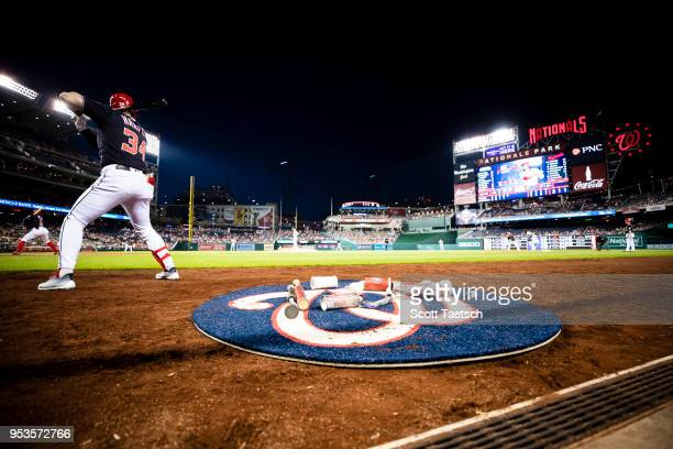 Bryce Harper of the Washington Nationals warms up in the batters circle before hitting a three run home run against the Pittsburgh Pirates during the...