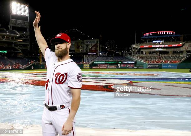 Bryce Harper of the Washington Nationals waves to the crowd following the Nationals 93 win over the Miami Marlins during their last home game of the...