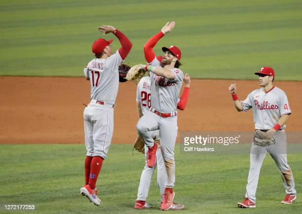 Bryce Harper, Rhys Hoskins of the Philadelphia Phillies and teammates celebrate their 12 to 6 win over the Miami Marlins at Marlins Park on September...