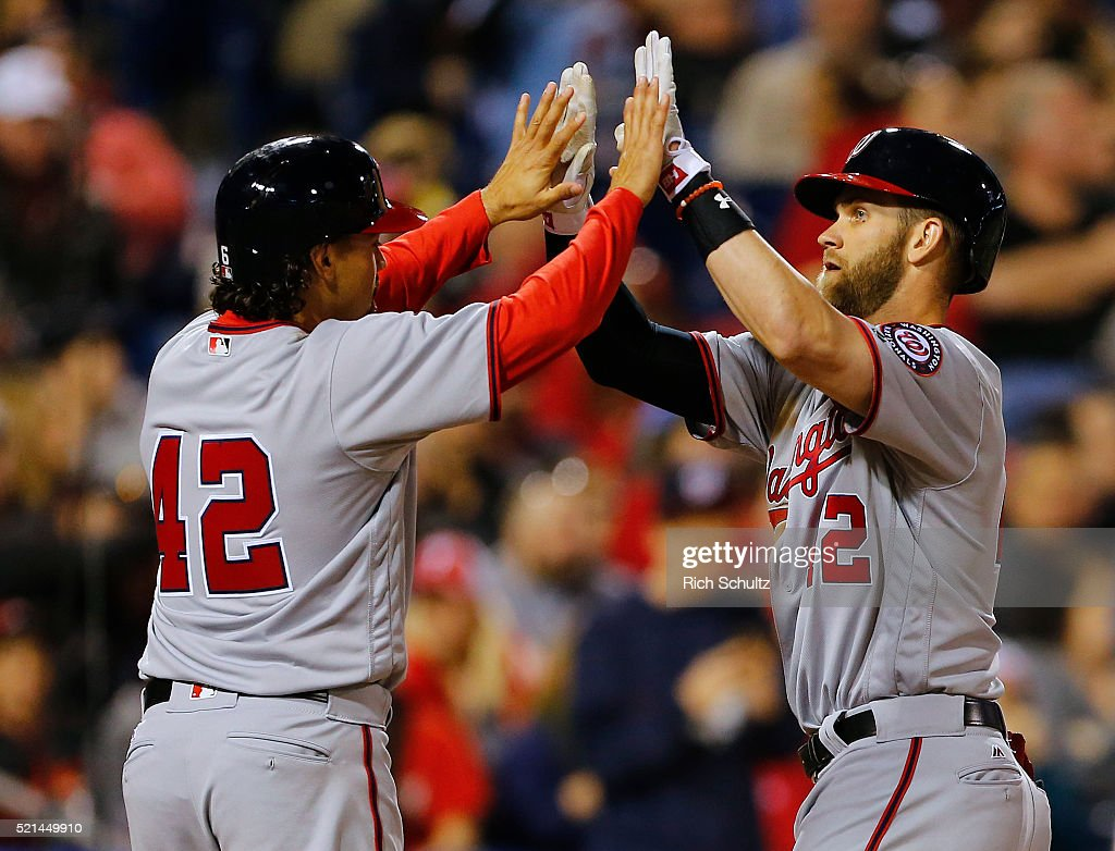 Bryce Harper, right, of the Washington Nationals is congratulated by teammate Anthony Rendon, left, after he hit a two run home run during the sixth inning against the Philadelphia Phillies in an MLB game at Citizens Bank Park on April 15, 2016 in Philadelphia, Pennsylvania. All players are wearing #42 in honor of Jackie Robinson.