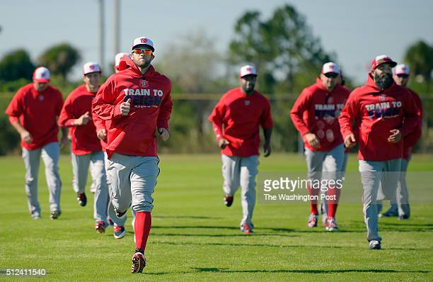 Bryce Harper runs with his teammates during warm up exercises as the Washington Nationals start of their first day of fullsquad spring training camp...