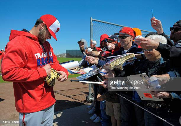 Bryce harper signs autographs during the Washington Nationals start of their first day of fullsquad spring training camp at Space Coast Stadium in...