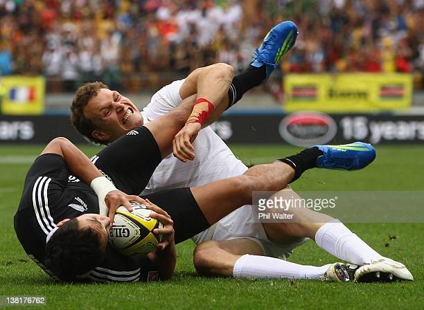 Bryce Heem of New Zealand is tackled by Tom Powell of England during the match between New Zealand and England on day two of the Wellington Sevens at...