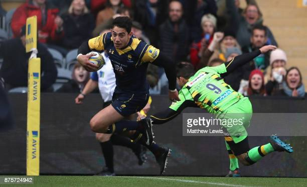 Bryce Heem of Worcester Warriors beats the tackle from Cobus Reinach of Northampton Saints to score a try during the Aviva Premiership match between...