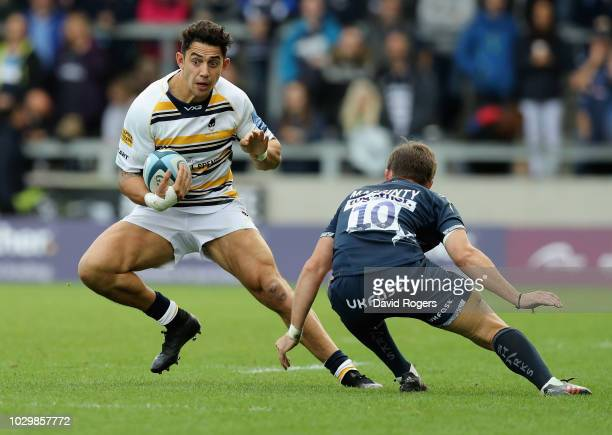 Bryce Heem of Worcester Warriors goes past AJ MacGinty during the Gallagher Premiership Rugby match between Sale Sharks and Worcester Warriors at the...