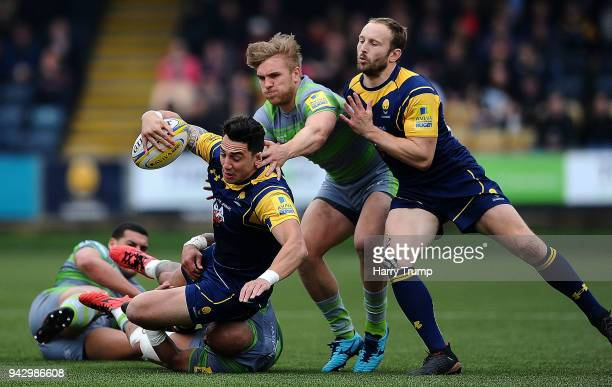 Bryce Heem of Worcester Warriors is tackled by Nili Latu of Newcastle Falcons and Charlie Harris of Newcastle Falcons during the Aviva Premiership...