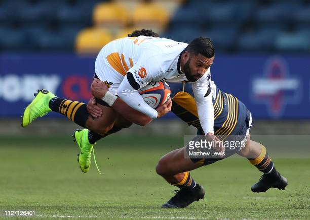 Bryce Heem of Worcester Warriors tackles Lima Sopoaga of Wasps during the Premiership Rugby Cup match between Worcester Warriors and Wasps at Sixways...