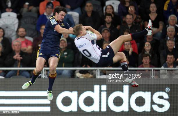 Bryce Hegarty of the Rebels and Richard Buckman of the Highlanders compete for the ball during the round eight Super Rugby match between the...