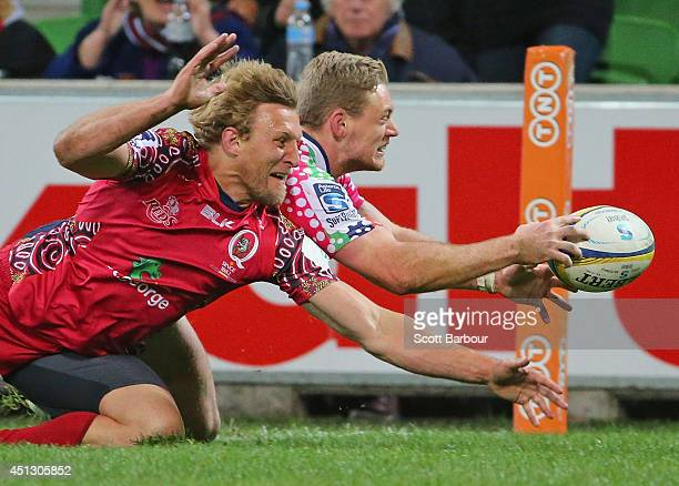 Bryce Hegarty of the Rebels dives to score a try during the round 17 Super Rugby match between the Rebels and the Reds at AAMI Park on June 27 2014...