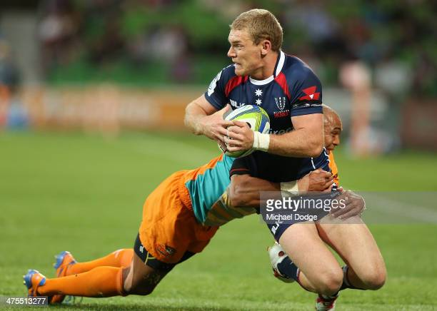 Bryce Hegarty of the Rebels is tackled by Cornal Hendricks of the Cheetahs during the round three Super Rugby match between the Melbourne Rebels and...