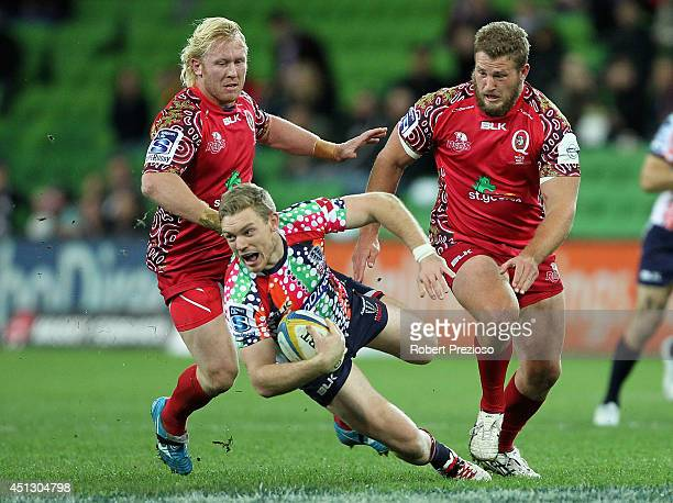 Bryce Hegarty of the Rebels runs with the ball during the round 17 Super Rugby match between the Rebels and the Reds at AAMI Park on June 27 2014 in...